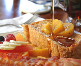 Peach French toast served with fresh bacon strips